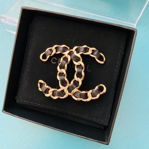 Chanel CC logo leather chain pin